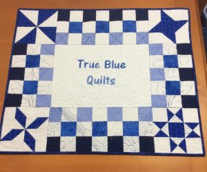 quilted banner for True Blue Quilts