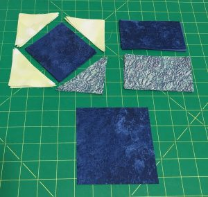 cut pieces for rolling stone quilt block
