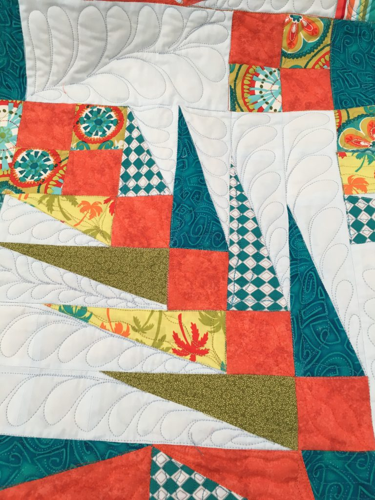 stitchinfree motion feathers on angle play quilt