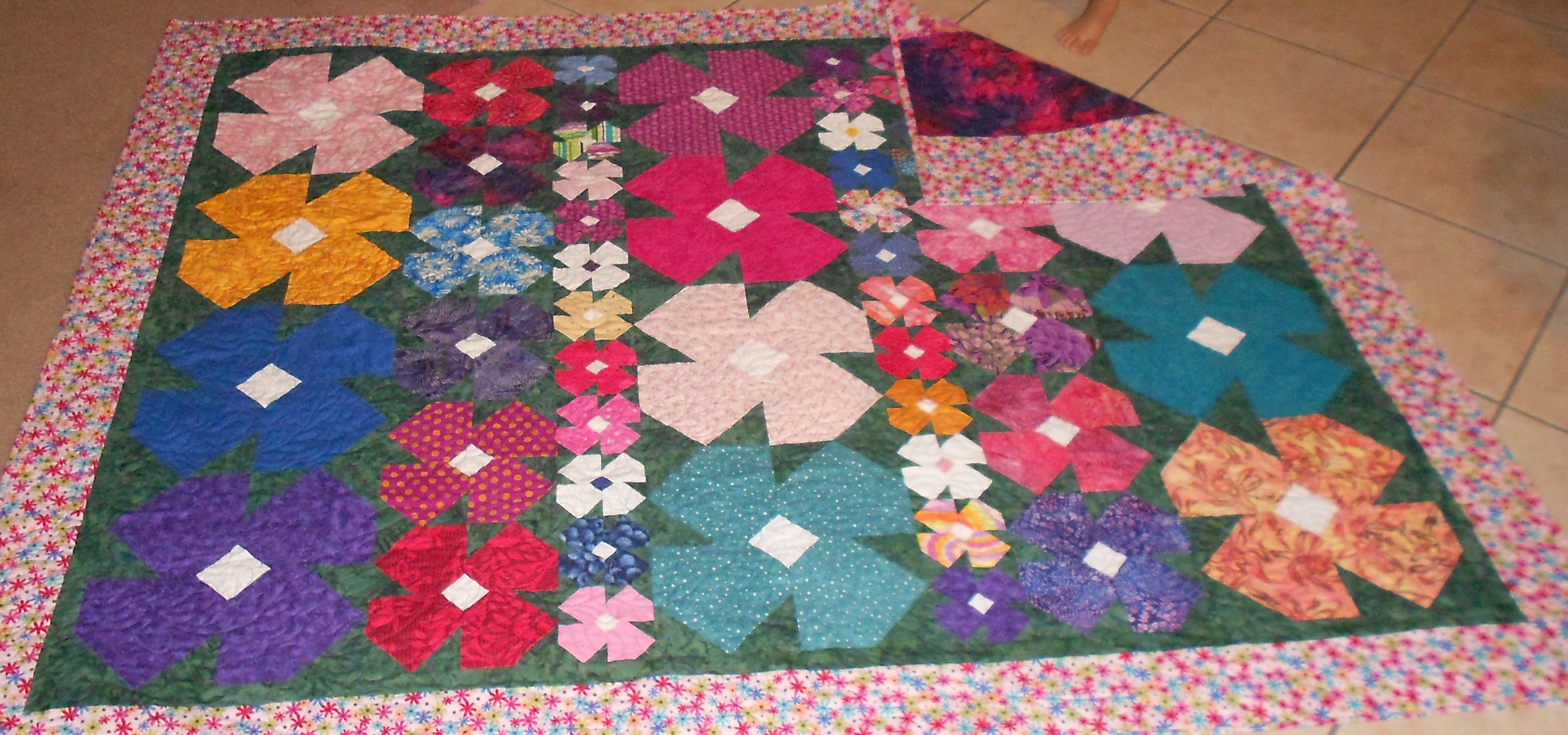 Garden quilt blocks : Putting the different sized blocks into rows is one way to solve