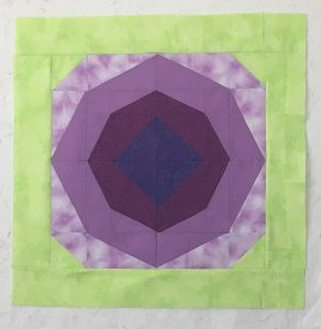 24-inch mini quilt with Blossom AnglePlay blocks
