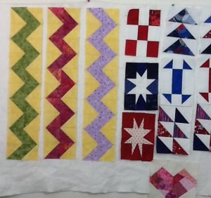 quilt blocks on the design wall