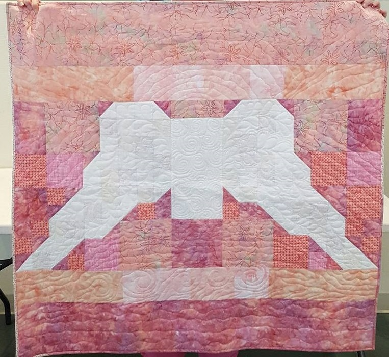 Angel Wings quilt in pink fabric