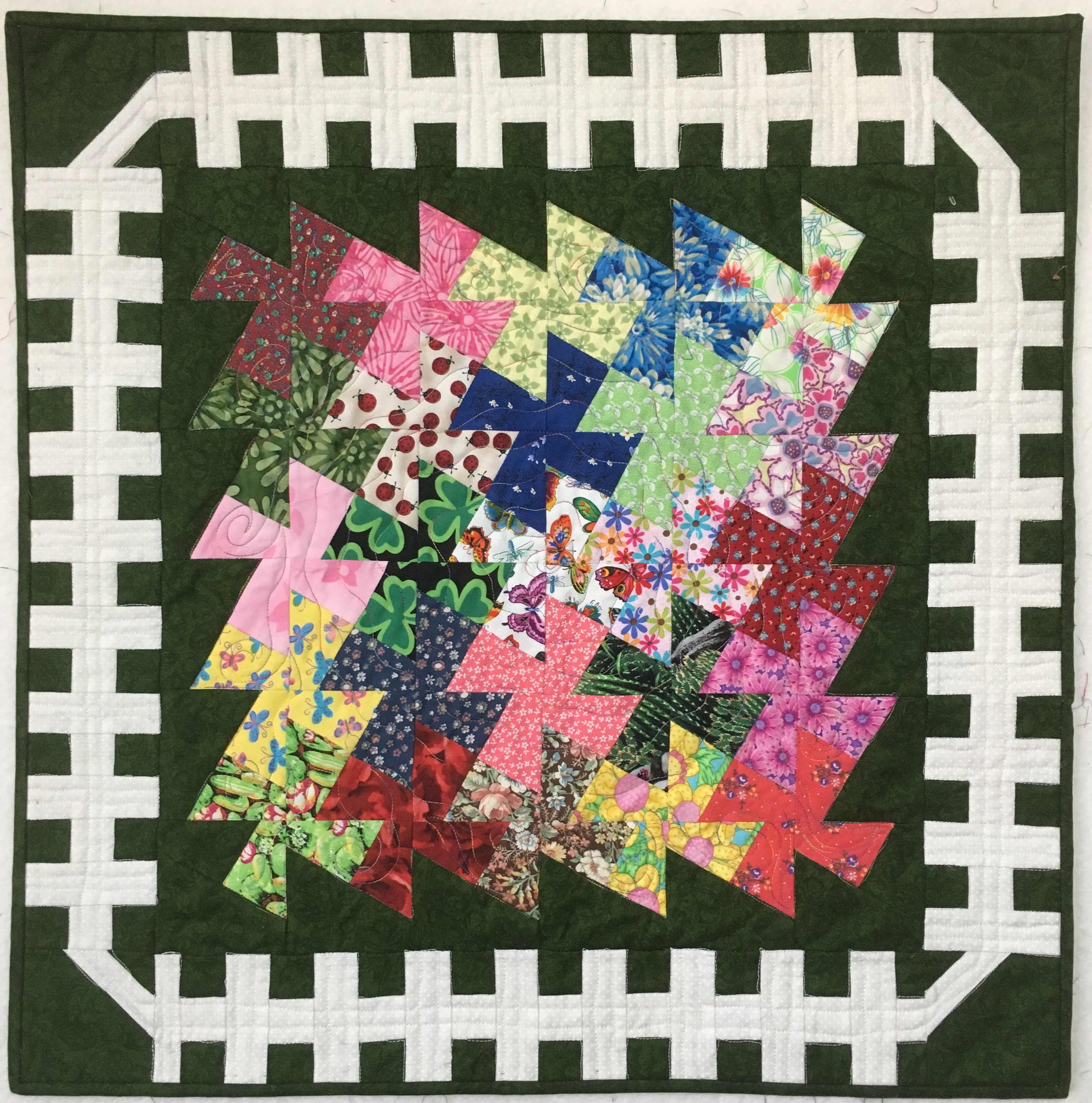 Garden Twister quilt by Andi Stanfield