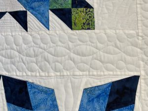 dna quilting in the Traveling Puzzle quilt