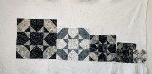 gradually smaller quilt blocks