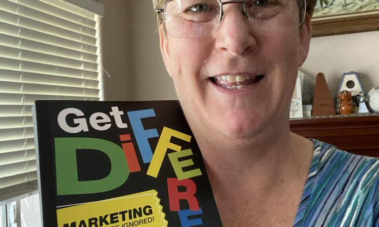Andi with Get Different book